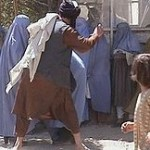 Taliban beating women