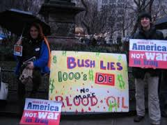 No blood for oil placards