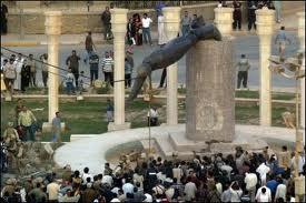 Saddam statue topples
